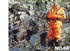 photo of a man next to an oil spill